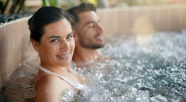 how soon can you use hot tub after adding chemicals